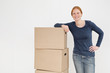Happy Woman with Moving Boxes