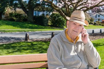 Healthy Senior Man Talking on Cell Phone in Park