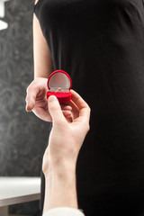 Closeup photo of woman accepting diamond ring from man