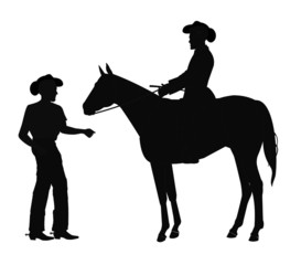 cowboys in silhouette