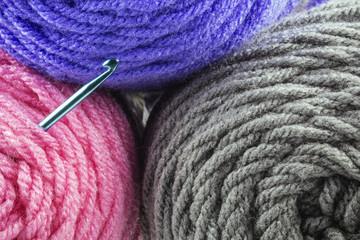 Rolls of Yarn and Crochet Hook