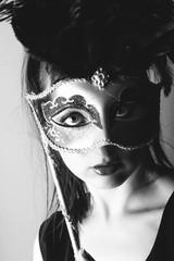 beautiful young girl with venetian mask