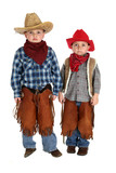two cute young cowboys standing and posing wearing hats, boots,