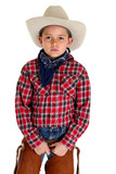 Young cowboy with a serious look peering at camera