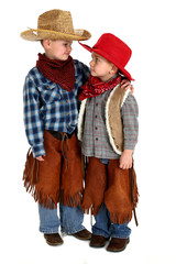 young cowboy brothers looking at each other hugging