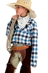 profile of a young cowboy peering holding rope