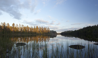 Swedish lake, at dusk, cloud reflections in the water