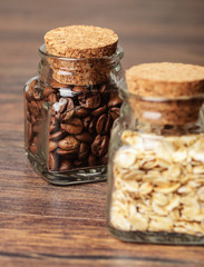 Coffee beans and oats in two jars