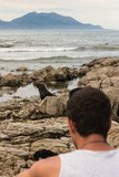 young man watching seal pup