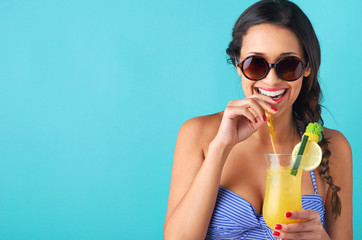Woman with tropical cocktail