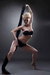 Shot of sensual young blonde dancing with cloth