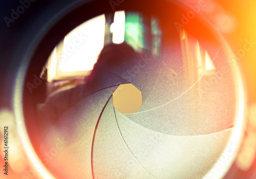 The diaphragm of a camera lens. Color toned image. - 61612912