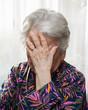 Senior woman suffering from headache
