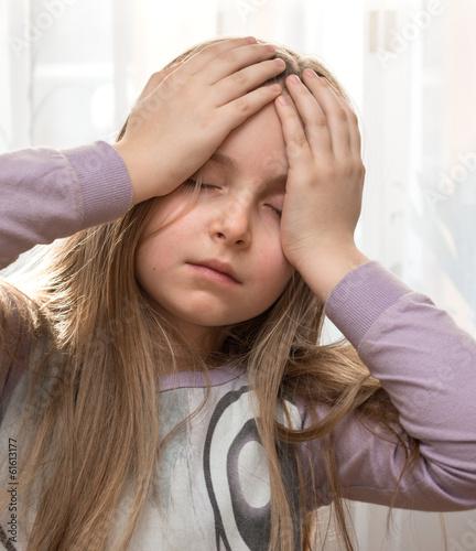 Girl suffering from headache