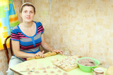 Woman making russian meat dumplings