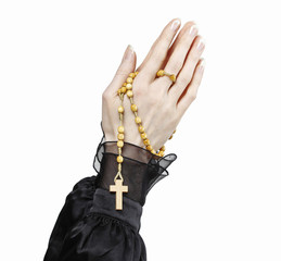 Hands holding black rosary isolated on white background.