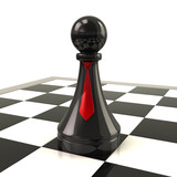 Black pawn with red ties on desk
