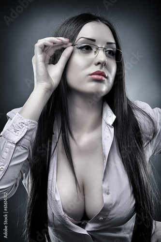 Sexy teacher wearing glasses