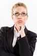 Portrait of attractive businesswoman thinking.