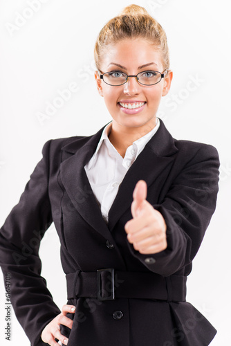 Portrait of businesswoman showing thumbs up