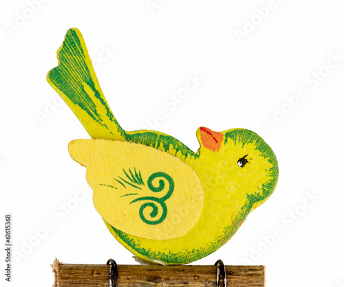 Cute yellow bird carved of wood