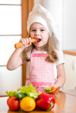 kid girl eating vegetables