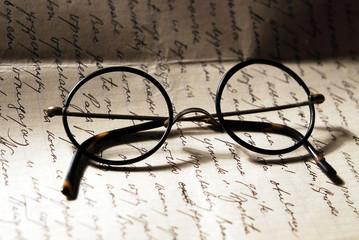 Old glasses on a letter