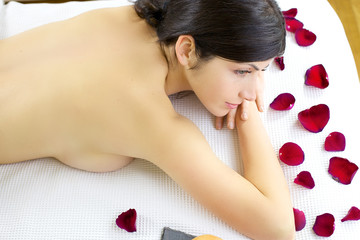 Woman naked waiting for massage in spa