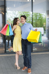 Grateful woman thanking her boyfriend for successful shopping