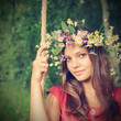beauty girl on swing outdoors