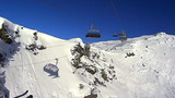 Ski lift chairs on bright winter day, Alps, Zillertal, Austria