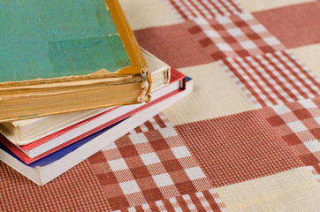 new and old books on the squared tablecloth