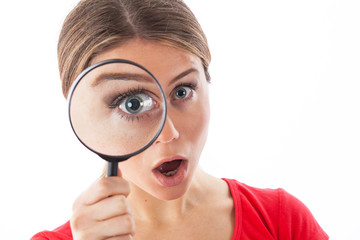 Young woman with a magnifying glass