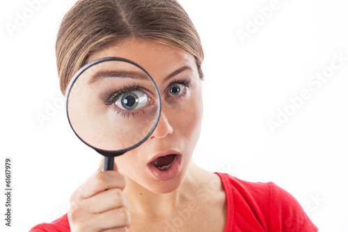 canvas print picture Young woman with a magnifying glass