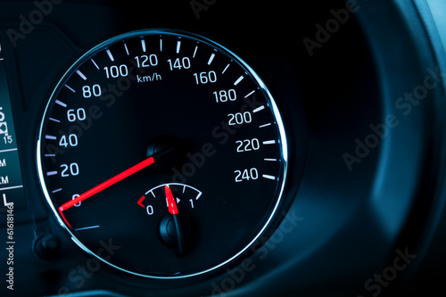 Closeup photo ob modern automotive speedometer on black