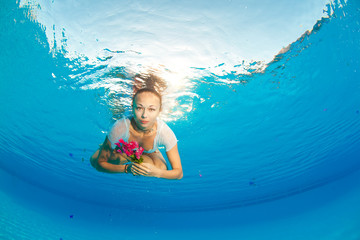 underwater portrait with flower
