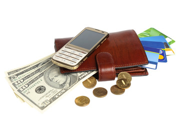 Purse with money, credit cards and mobile phone isolated on whit
