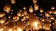 Launching flying lanterns in the night sky