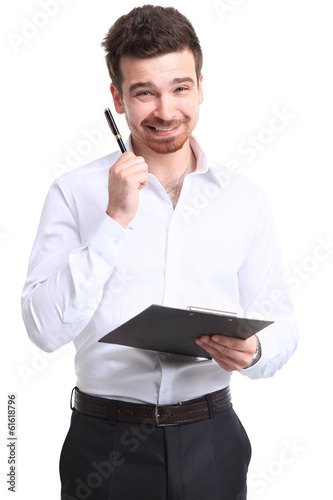 Portrait of cheerful businessman making notes and looking at cam