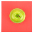 Green apple on red napkin