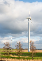 Rotating wind turbines in a Dutch landscape