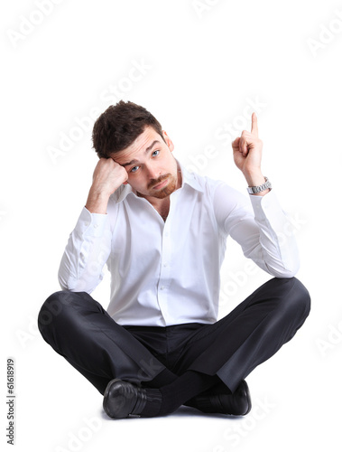business man sitting on the floor with shocked facial expression