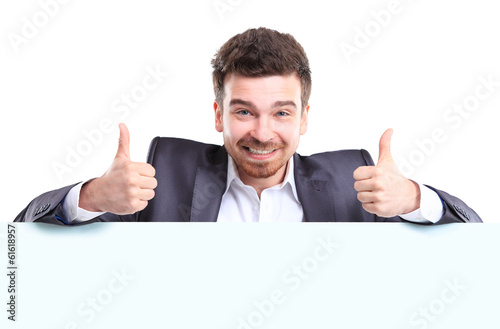 Happy business man with thumbs up gesture presenting