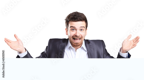 Happy business man with shocked facial expression presenting