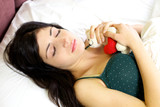 Woman dreaming of boyfriend in love holding plush