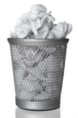 Wastepaper in rubbish bin closeup