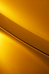 golden glitter curved vehicle panel abstract