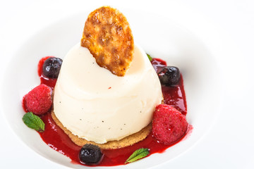 Italian pana cotta with berry compote