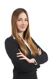 Confident beautiful business woman posing with folded arms