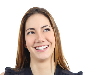 Happy woman with perfect white smile looking sideways